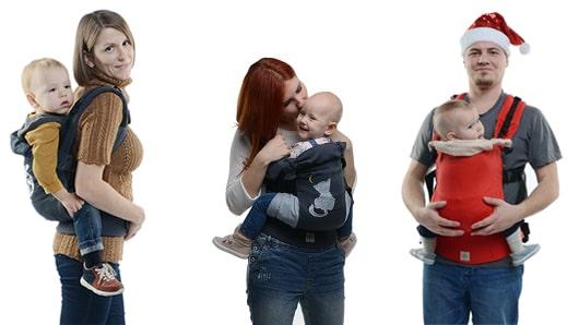 Мама в эрго целует ребенка